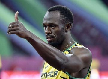 Bolt y Gatlin clasifican en 100 metros