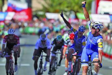 Lampaert sorprende en un kilómetro de oro y se viste de rojo en la Vuelta a España
