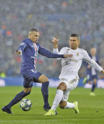 Real Madrid y París Saint-Germain se reparten honores