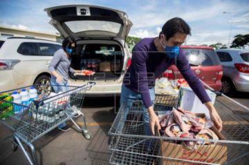 América busca activarse ante anuncios de recesión e incremento de contagios