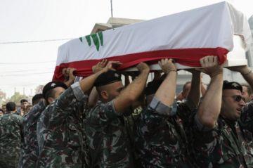 Los libaneses entierran a sus muertos y esperan un nuevo gobierno