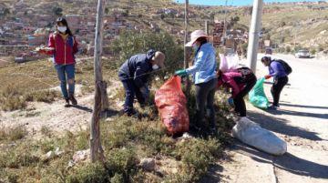 EMAP, voluntarios de Pasocap y Vecinos realizan limpieza en Villa Mecánicos