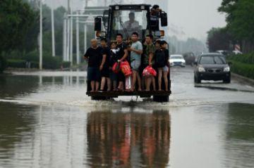 El balance de víctimas por las inundaciones en China se triplica y supera los 300 decesos