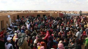 En un campo sirio, el dilema entre una muerte lenta o una salida arriesgada