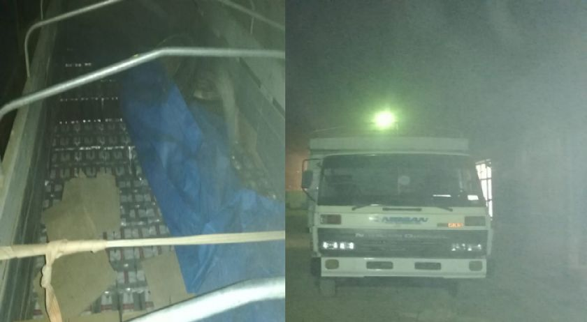 Policías fugan al ser descubiertos escoltando auto con contrabando