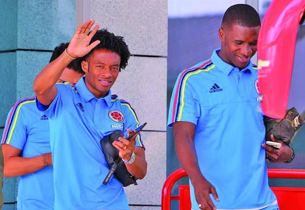 Los jugadores locales Juan Guillermo Cuadrado y Christian Zapata.
