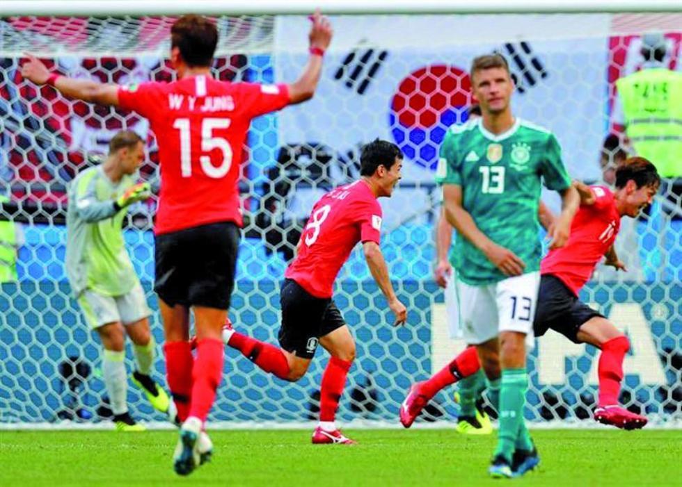 Los jugadores coreanos celebran el triunfo.