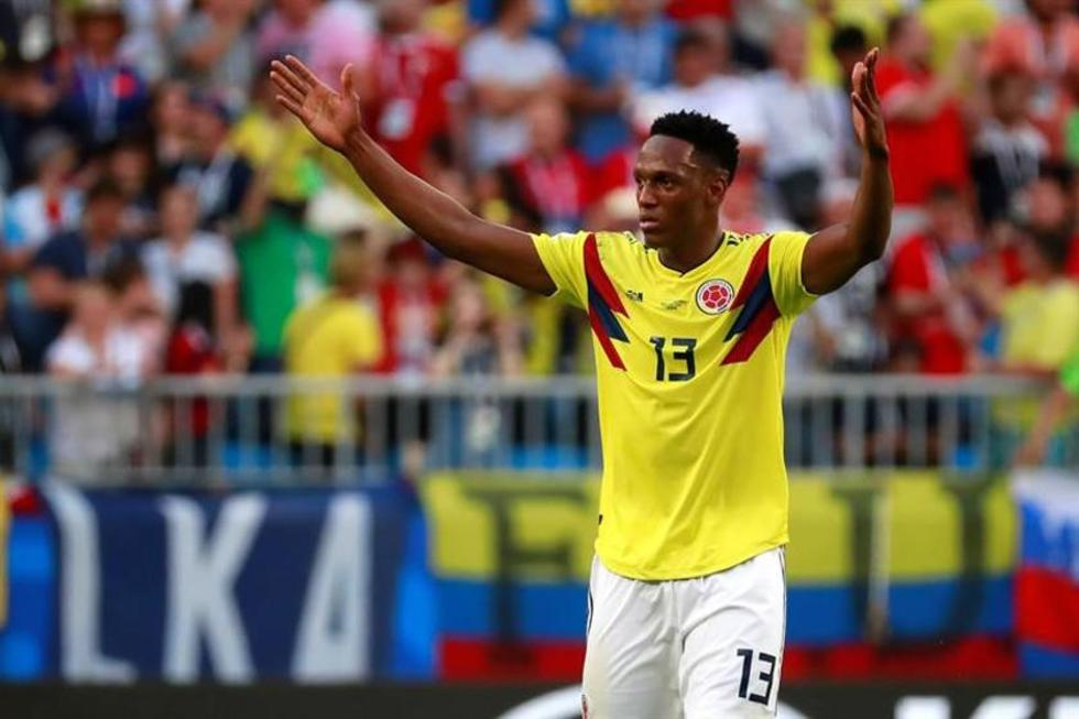 El defensa colombiano Yerry Mina celebra el gol de la victoria.
