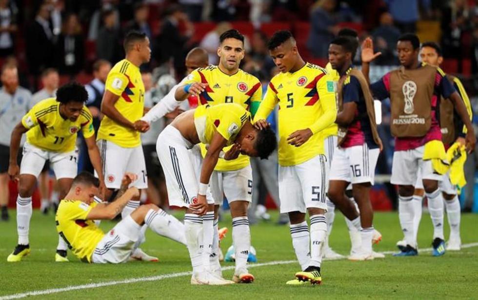 Los futbolistas sudamericanos lamentan la derrota tras los penales.