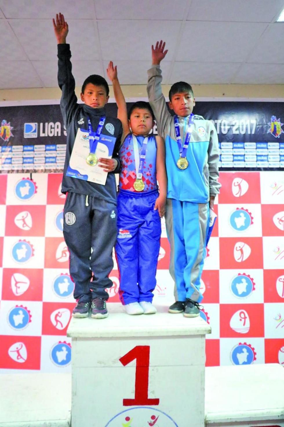 Los campeones Joel Pérez, Miguel Castro y Damian Troncoso.
