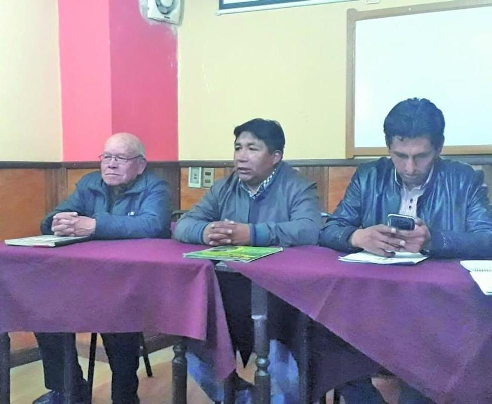 El expresidente interino, Juan de Uzin y el actual titular del club lila, Calixto Santos.